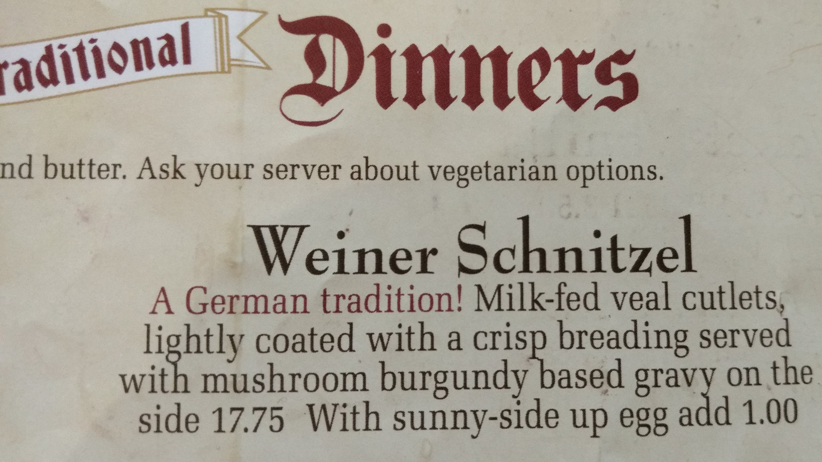 A weiner schnitzel in the menu of a german restaurant